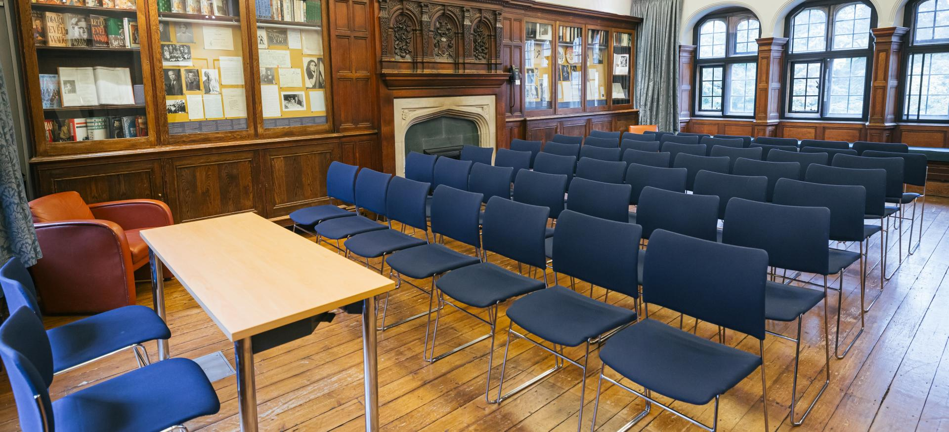 The Trinity College Sutro Room set up in lecture theatre style with chairs.