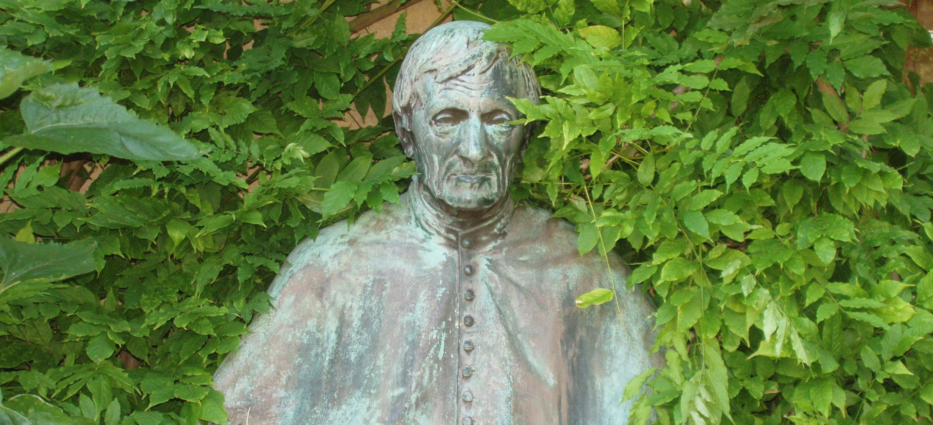 A bust of John Henry Newman sits in Trinity's Garden Quad.