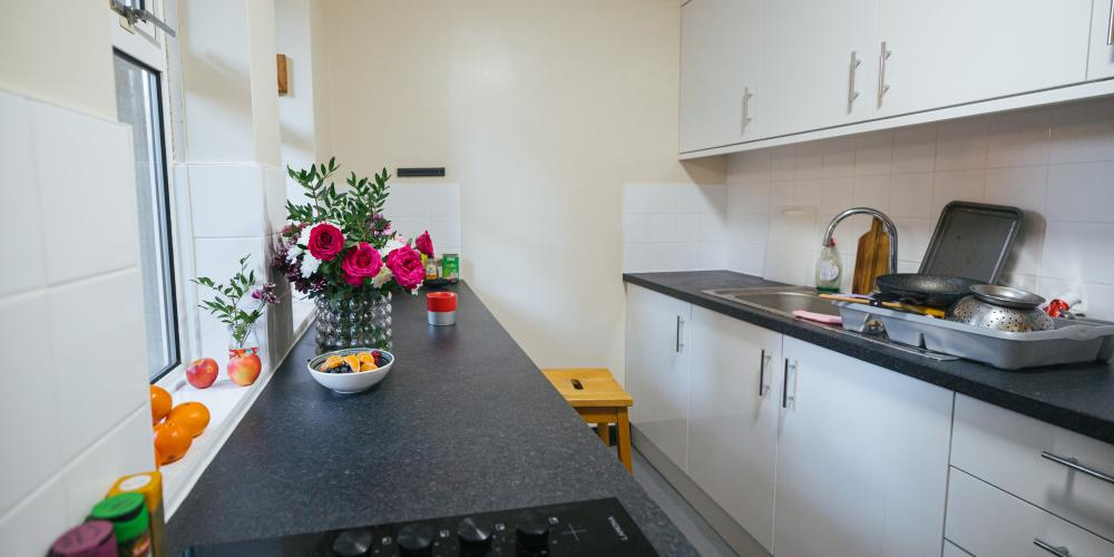 A shared kitchen area in Trinity's offsite Rawlinson Road property.