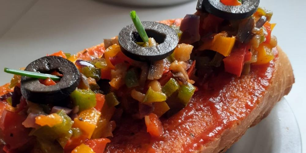 A bruschetta with ratatouille topping.