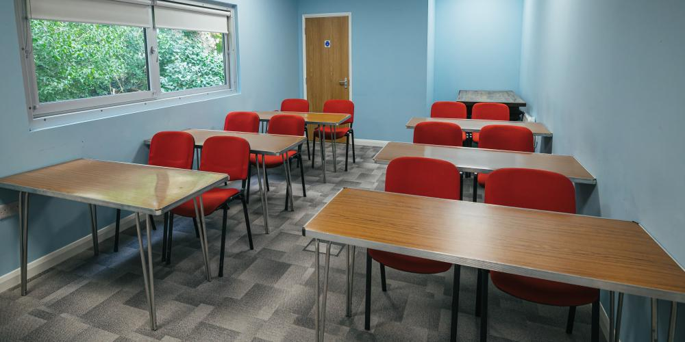 The Lawns Pavilion meeting room with classroom seating.
