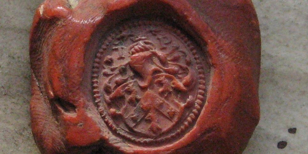 A signet seal in red wax.